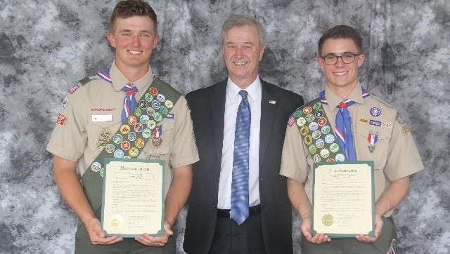 Eagle Scouts Chase Every (left) and Taylor Ufford received a proclamation from Plymouth Township Clerk Jerry Vorva at a recent Court of Honor.