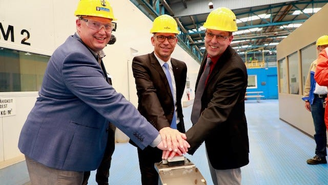 Executives from Royal Caribbean and the Meyer Werft shipyard in Papenburg, Germany mark the beginning of construction of Royal Caribbean's newest ship, Spectrum of the Seas.