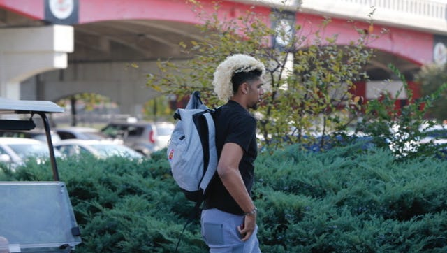 Louisville's Brian Bowen walking to the practice facility.