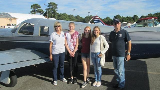 Kathy Francis, science teacher at St. Catharine School, Spring Lake, with students and pilot Perry Friedman