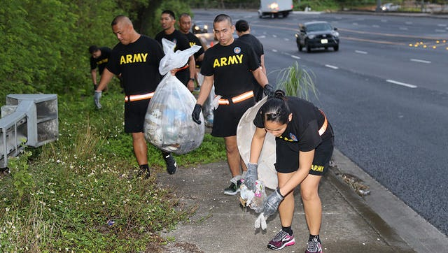 Guam National Guard members pick up trash along Route 16, in Barrigada, in February 2018. The Guard conducts monthly cleanups.