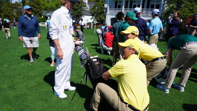 Logan Gonzalez, 13, and his father Mike talk strategy before Logan putted at the Drive, Chip and Putt finals at Augusta National.