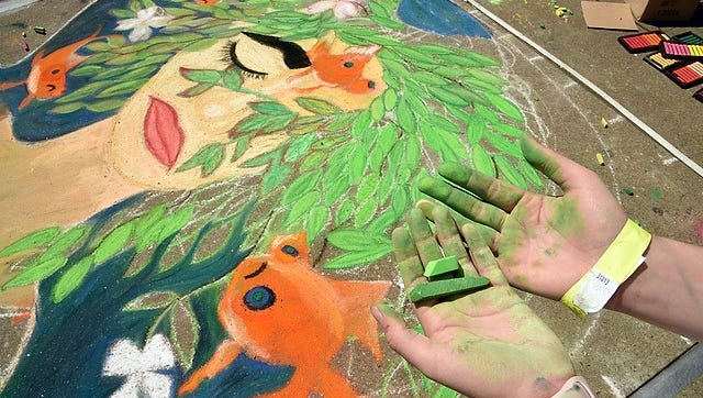 The hands of a chalk artist at the 10th annual Dogwood Arts Chalk Walk in Market Square on Saturday, April 21, 2018.