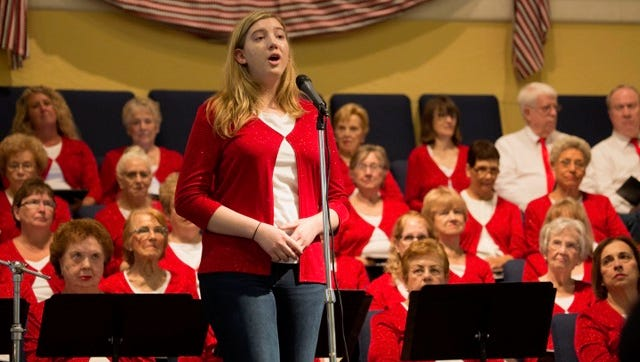 """Valerie Grau performs a solo during the Treasure Coast Community Singers concert """"You're A Grand Old Flag"""" on May 19 at North Stuart Baptist Church"""
