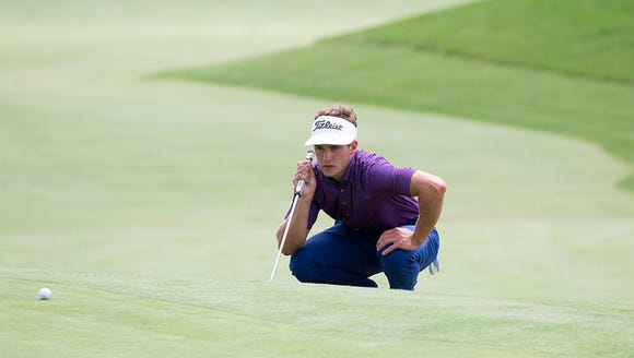 James Nicholas gets a read on a putt during stroke-play