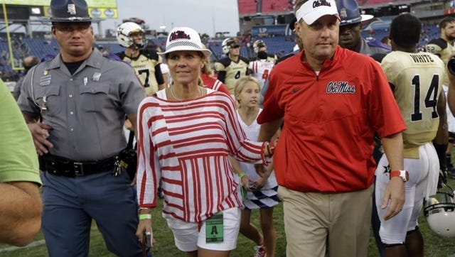Mississippi head coach Hugh Freeze leaves the field after beating Vanderbilt in an NCAA college football game Saturday, Sept. 6, 2014, in Nashville, Tenn. Mississippi won 41-3. (AP Photo/Mark Humphrey)
