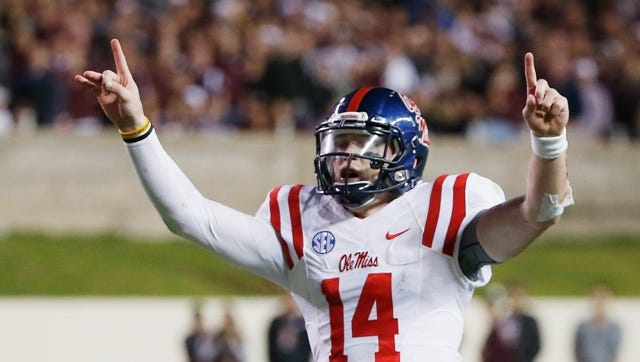 Ole Miss quarterback Bo Wallace celebrates during the team's 35-20 win against Texas A&M on Saturday.