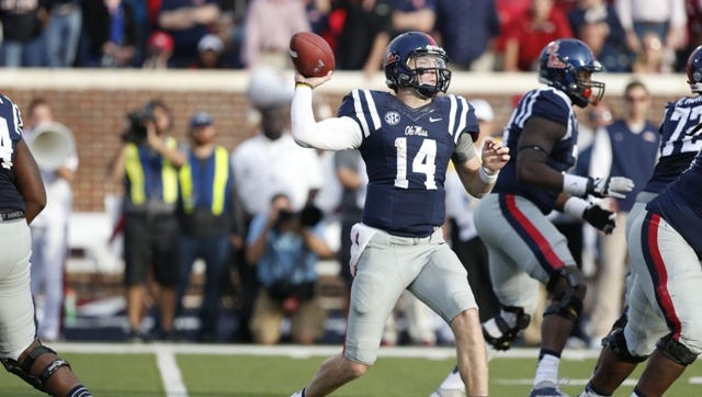 Ole Miss quarterback Bo Wallace sets up to pass against Alabama.