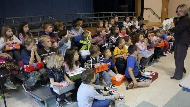 Ocean Road Elementary School second grade students learn about Veterans Day after preparing care packages for soldiers.