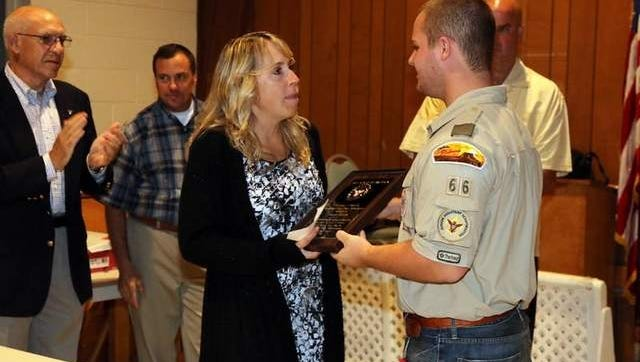 Theresa Fiorelli presents 2014 Eagle Scout Scholarship Award to Taylor Grillo