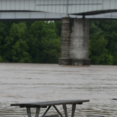 A picnic table is partially submerged at the Arthur