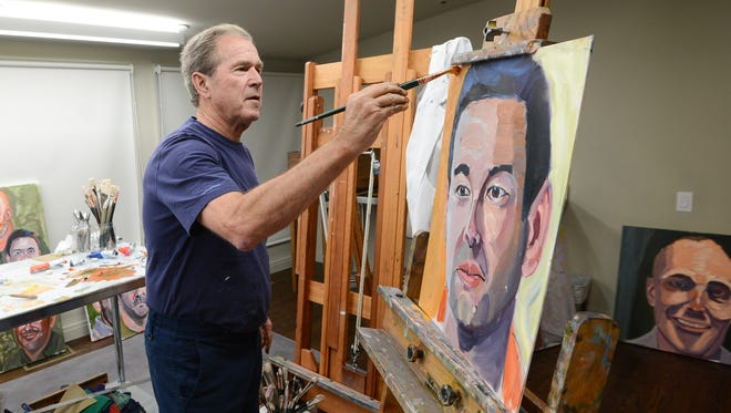 Former President George W. Bush worked on a painting in his Texas art studio in this May 30, 2016 photo.