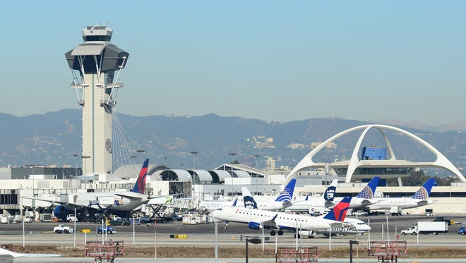 A Delta Airlines plane takes off from Los Angeles International Airport on November 1, 2013.