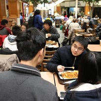 University of Iowa freshmen Ruijing Xiong, right, and Yunyi Li, both of China, sit down for lunch at the Old Capitol Town Center on Tuesday, Dec. 1, 2015.