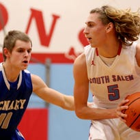 South Salem's Joe Carey (5) moves past McNary's Alex Martin (11) in the McNary vs. South Salem boy's basketball game at South Salem High School on Tuesday, Feb. 2, 2016. South Salem won the game 53-52.