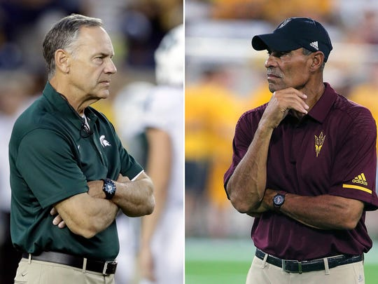 FILE - At left, in an Oct. 7, 2017, file photo, Michigan State head coach Mark Dantonio watches warmups before an NCAA college football game against Michigan, in Ann Arbor, Mich. At right, in a Sept. 1, 2018, file photo, Arizona State head coach Herm Edwards watches his team warm up prior to an NCAA college football game against UTSA, in Tempe, Ariz. No. 15 Michigan State at Arizona State. The Sun Devils kicked off the Herm Edwards era with a resounding victory, jumping on UTSA early on the way to a 49-7 victory. Arizona State should face a much higher level of competition against Michigan State, despite the Spartans struggles to put away Utah State last week.(AP Photo/Ralph File)