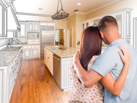 Young Military Couple Inside Custom Kitchen and Design Drawing