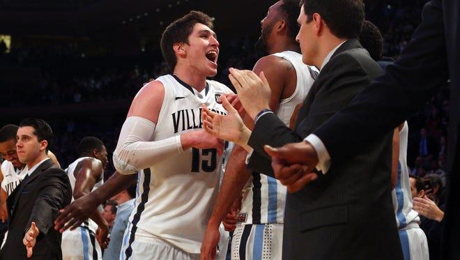 Ryan Arcidiacono (left) and Villanova celebrate winning the Big East Tournament at Madison Square Garden in March.
