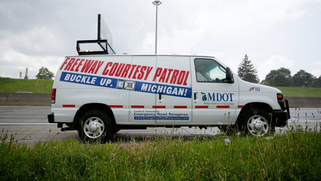 Michigan Department of Transportation Freeway Courtesy Patrol van makes a stop on the freeway on Tuesday, July 14, 2015, in Detroit. When motorists get stranded on the freeways around Metro Detroit, the white MDOT vans, operated under contract by Emergency Road Response, stop to provide service.