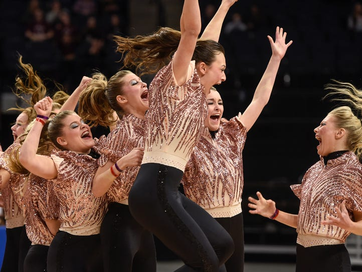 Sartell Dance Team members celebrate their state championship
