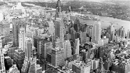 From the 1,250-foot-high observation tower of the Empire State Building, a panoramic view of Midtown Manhattan is seen on Sept. 12, 1938.