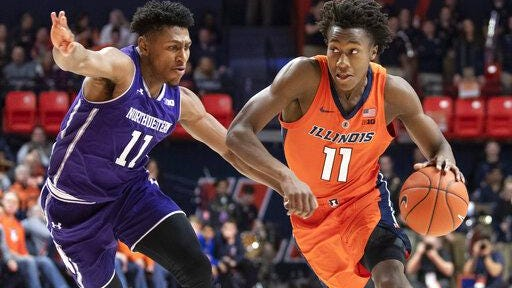 Illinois guard Ayo Dosunmu (11) drives to the basket against Northwestern guard Anthony Gaines (11) during the first half of a game in Champaign on Sunday, March 3, 2019.