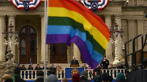 An LGBT supporter attended Michigan Gov. Rick Snyder's inaugural address in 2015. Survey results from nearly 900 transgender Michigan residents were released Wednesday that show they want more support in the state. Results are part of a national survey conducted in 2015.