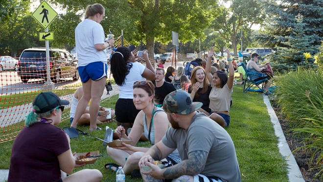 Crowds and food trucks gathered for food, fun and music at the Coloradoan's June Food Truck Festival on Thursday, June 13, 2017.