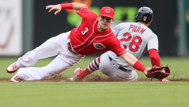Cincinnati Reds second baseman Scooter Gennett (3) saves a throw from going into the outfield as St. Louis Cardinals center fielder Tommy Pham (28) steals second base in the third inning during the National League baseball game between the St. Louis Cardinals and the Cincinnati Reds, Saturday, April 14, 2018, at Great American Ball Park in Cincinnati.