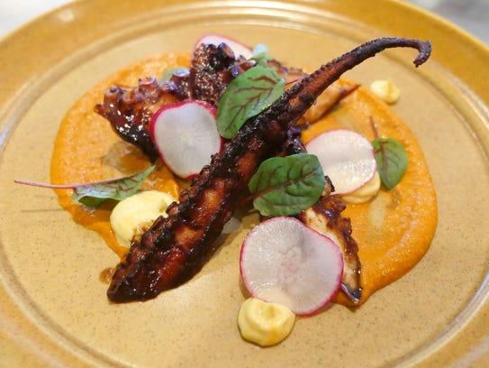 The octopus a la plancha, with spicy romesco, saffron