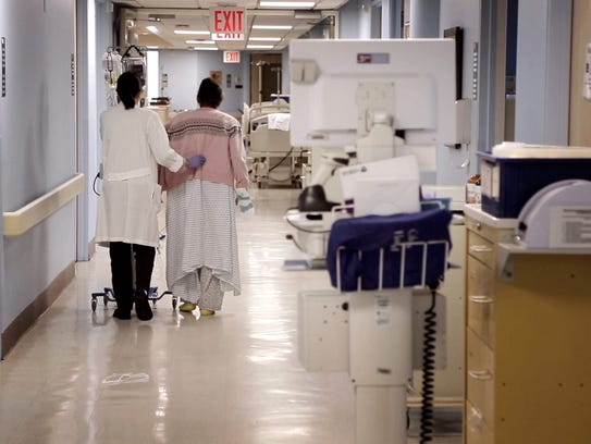 """A patient in the documentary film """"Defining Hope"""" walks"""