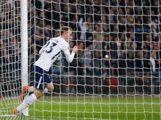 Tottenham's Christian Eriksen celebrates after scoring his sides first goal during the English Premier League soccer match between Tottenham Hotspur and Manchester City at Wembley stadium in London, England, Saturday, April 14, 2018. (AP Photo/Frank Augstein)