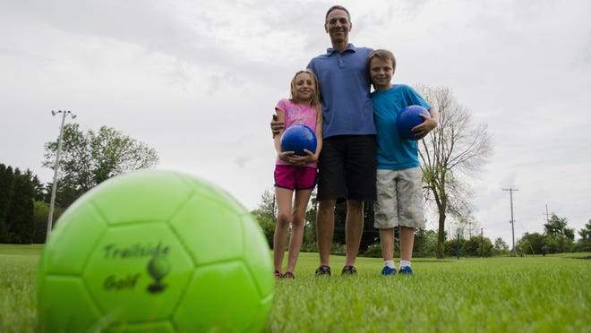 David Jordan poses with two of his children at Trailside Golf Course on Thursday, June 18.