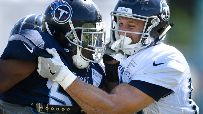 Titans outside linebacker Gimel President (57) and Titans tight end Anthony Firkser (86) compete during pass rush drills at practice at Saint Thomas Sports Park Sunday, July 29, 2018, in Nashville, Tenn.