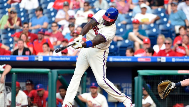 Philadelphia Phillies' Ryan Howard hits a ground ball to Milwaukee Brewers relief pitcher Jeremy Jeffress in the ninth inning to end Saturday's game. A Phillies fan threw a beer bottle at Howard as he walked off the field.