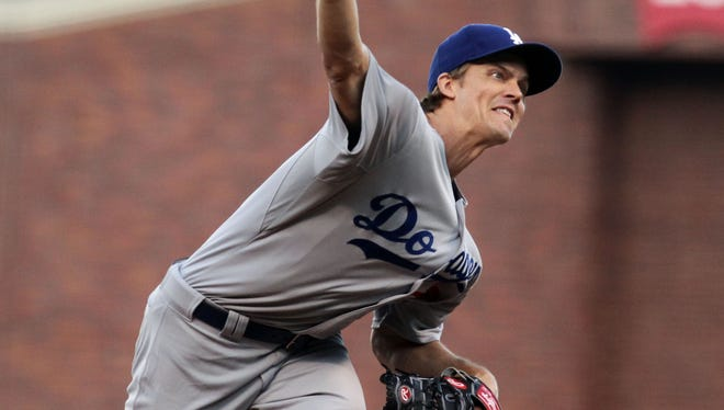 Los Angeles Dodgers starting pitcher Zack Greinke throws to the San Francisco Giants in the first inning of their MLB baseball game at AT&T Park.