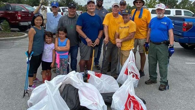 The New River Rotary Club members and family recently came together to clean up the Jacksonville Landing Boating Access Area in downtown Jacksonville.