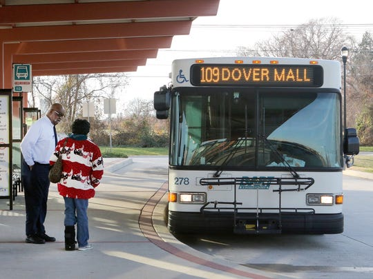 A bus rider at the Dover Transit Center consults a DART Statewide Bus Service driver during a stop on Monday.