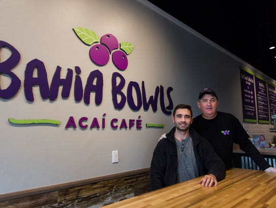 Bahia Bowls co-owner Ben Casey with his father and business partner, Steve Casey, at their flagship store in Estero on Monday, Jan. 8, 2018. The business, which specializes in customizable smoothies and açaí bowls, was started by Ben and Steve Casey and a family friend.