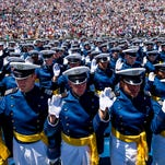 Cadets raise their right hands as they take the oath of office to become 2nd lieutenants during the graduation ceremony for the U.S. Air Force Academy class of 2014 at Falcon Stadium in Colorado Springs, Colo. on May 28, 2014.
