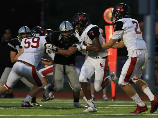 Jamal Allen runs the ball Friday for Livonia Churchill. The Chargers were in control most of the night against Plymouth.