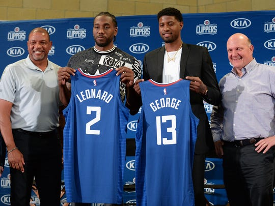 July 24, 2019; Los Angeles, CA, USA; Los Angeles Clippers players Kawhi Leonard and Paul George are introduced at Green Meadows Recreation Center. Los Angeles Clippers president of basketball operations Lawrence Frank, head coach Doc Rivers and owner Steve Ballmer are pictured. Mandatory Credit: Gary A. Vasquez-USA TODAY Sports
