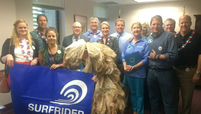 Members of the Surfrider Foundation are ready to celebrate their Florida Coasts and Oceans Lobby Day at the Capitol on Jan. 21