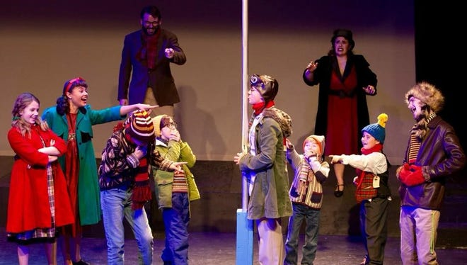 """Nathan Williamson as Jean Shepherd, Courtney Fitzgerald as Ms. Shields, Keen Williams as Flick in """"A Christmas Story: The Musical.""""  Kids: Ella Leaman, Indya Lincicome, David Buchner, Mallori Griesl, Finnegan Griesl, Carson Broome, Bradley Gay"""