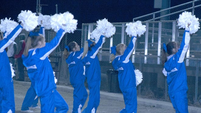 The West Franklin cheerleaders try to rev up the home crowd in the spirit during Friday's homecoming game.