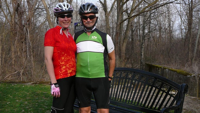 Zelma Kostyshak and the late Stephen Amberg, of Spencerport, during a bike ride along the Erie Canal Towpath Trail in Greece. The couple logged 17,000 miles on their bikes between Steve's initial cancer diagnosis in 2010 and mid-October 2016.
