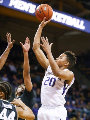 Huskies guard Markelle Fultz (right) shoots against  Colorado during a Jan. 18 game in Seattle. Fultz scored 37 as the UW won 85-83 in overtime.