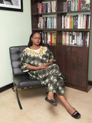Novelist Edwidge Danticat poses for a photo session at her home/office in Miami, Fla.