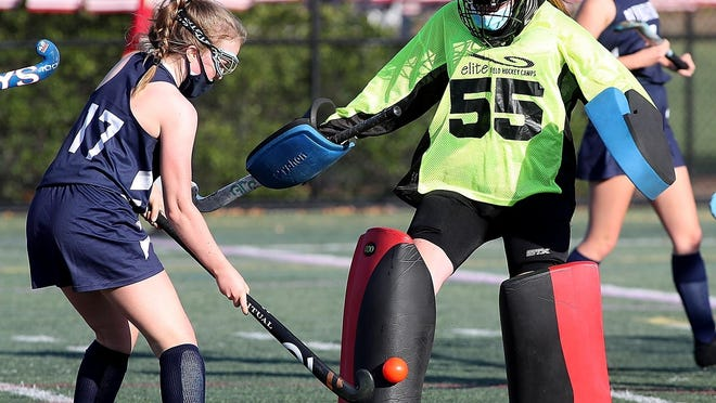 Plymouth North's Maeve Campbell puts a shot on Hingham goalie Maddie Decelles in action from earlier this season. Campbell exploded for five goals Thursday night in a 5-1 win over Plymouth South.