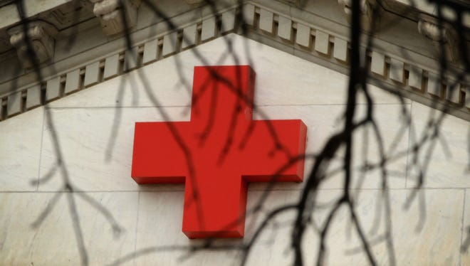 A file photo of a red cross is seen on The American Red Cross National Headquarters October 29, 2014 in Washington, DC. Reno Red Cross volunteers helped 13 people who were displaced in four recent house fire during Thanksgiving week.